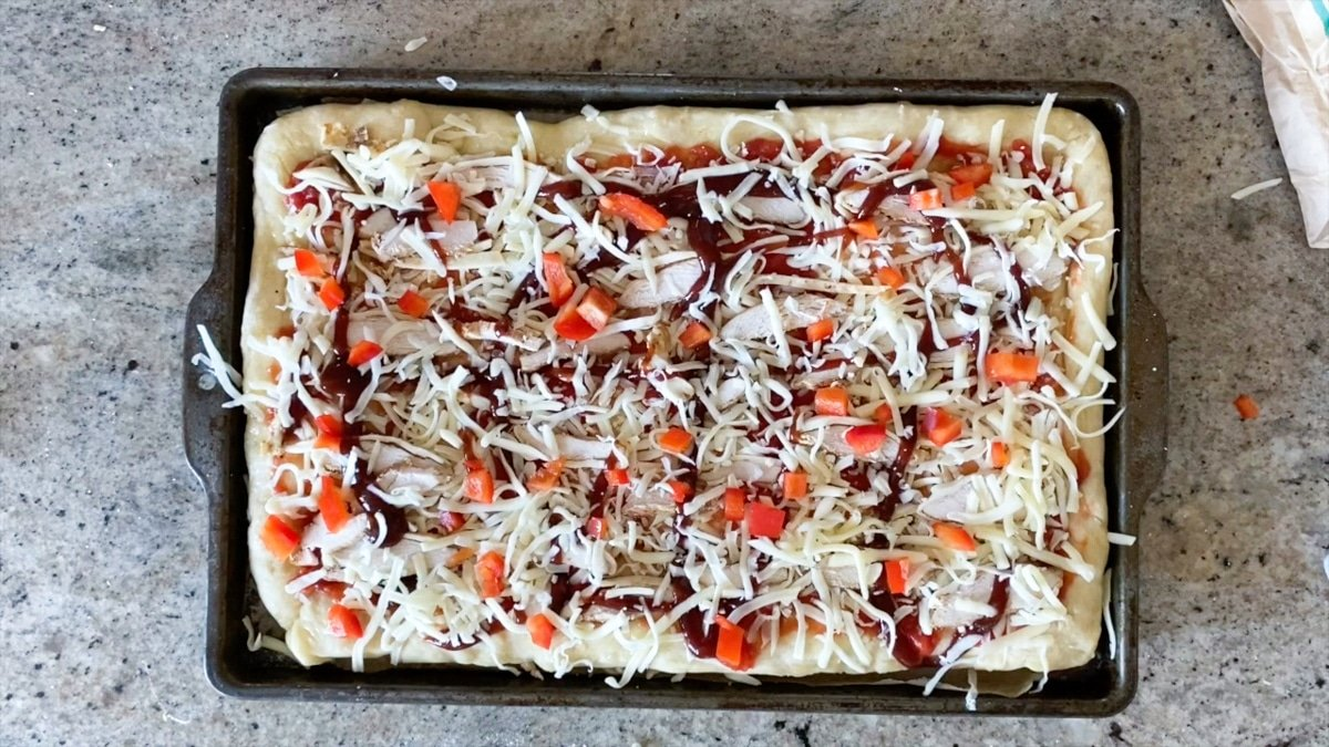 adding toppings for bbq chicken pizza