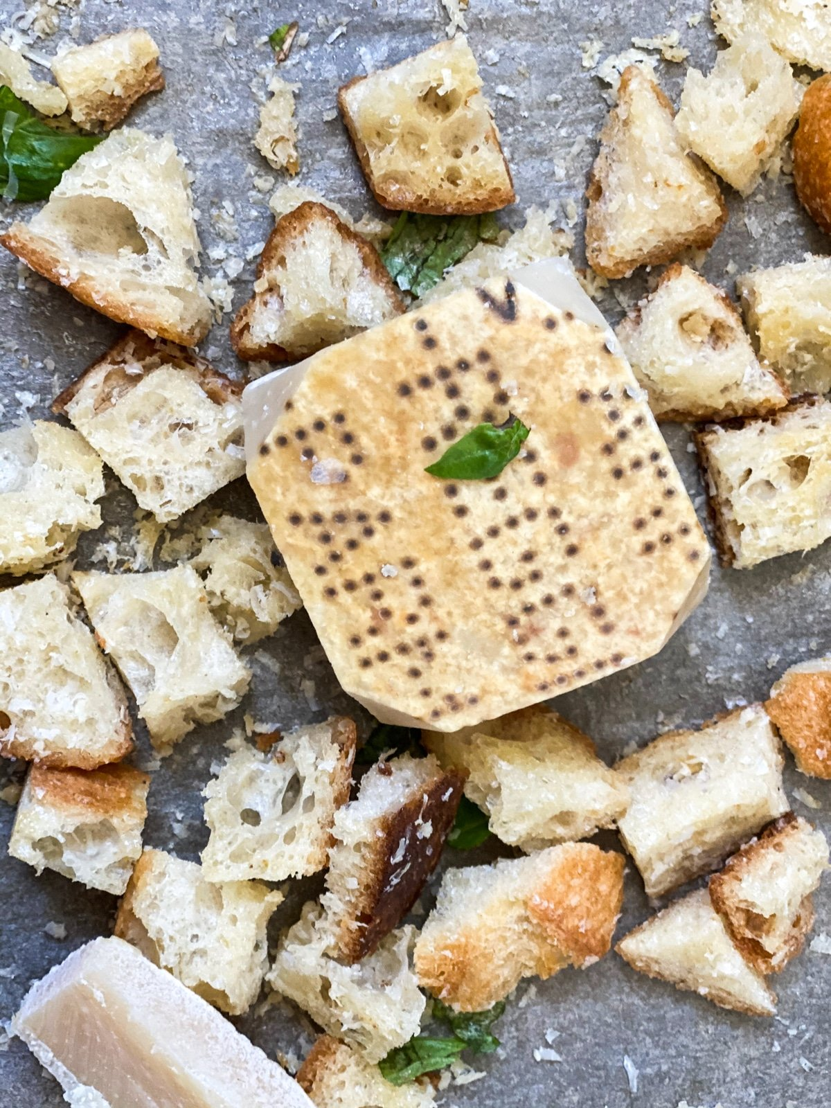 Croutons with fresh block of Parmesan