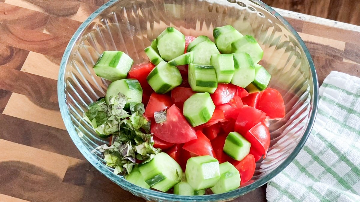 salad with tomatoes and cukes in a bowl with basil