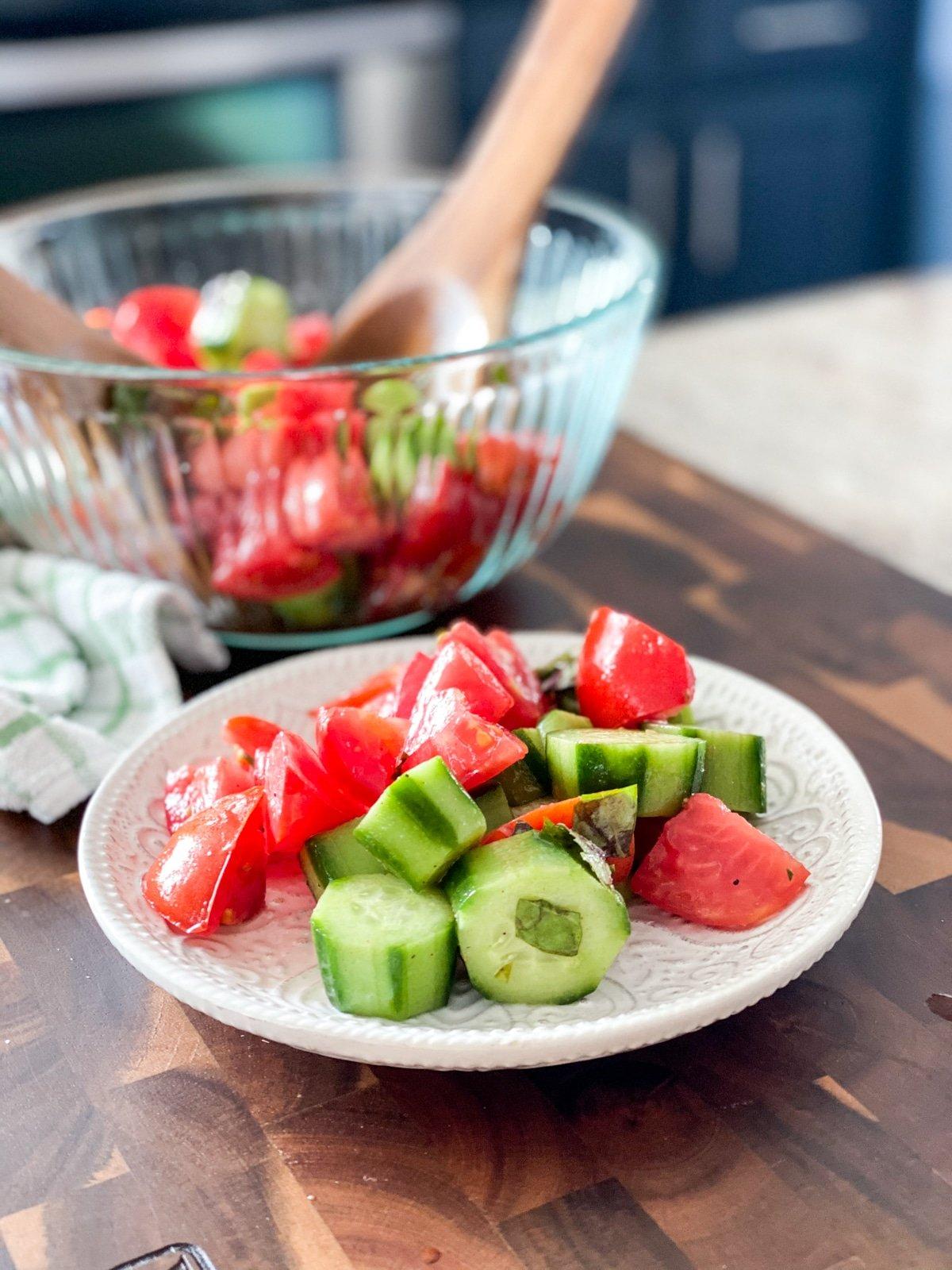 Serving a Tomato Cucumber Salad Marinated In Vinegar