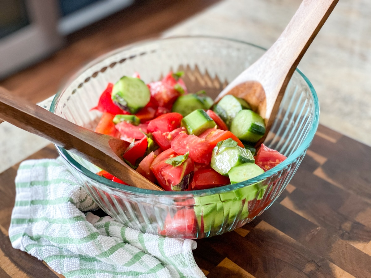 marinating tomatoes and cucumbers in vinegar dressing