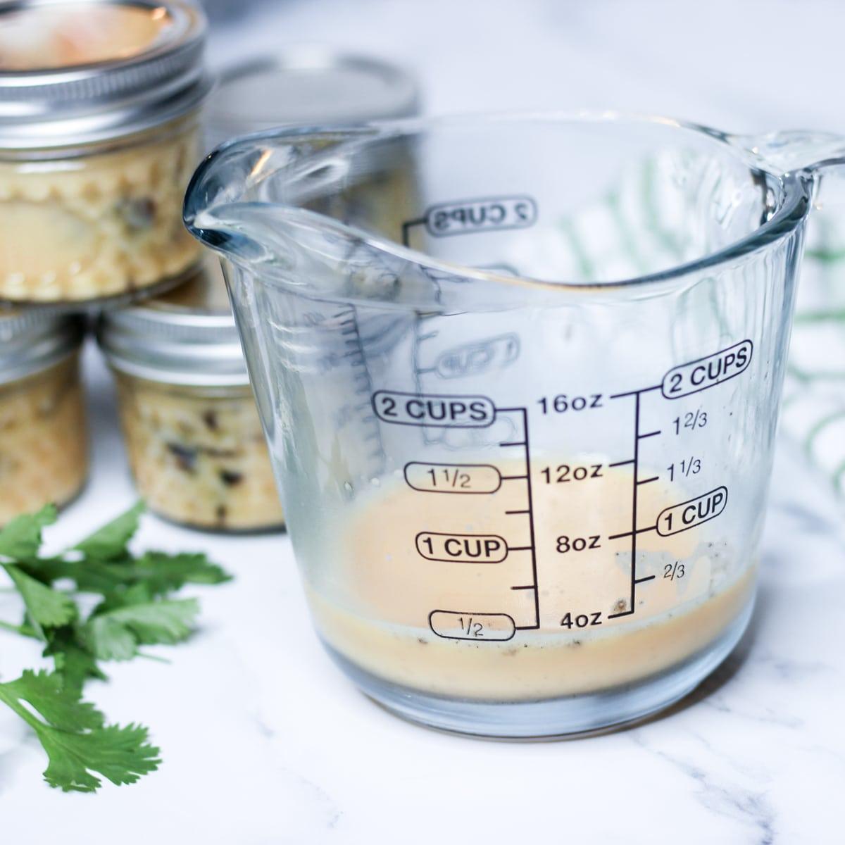 whisked egg for sous vide egg bites in measuring cup
