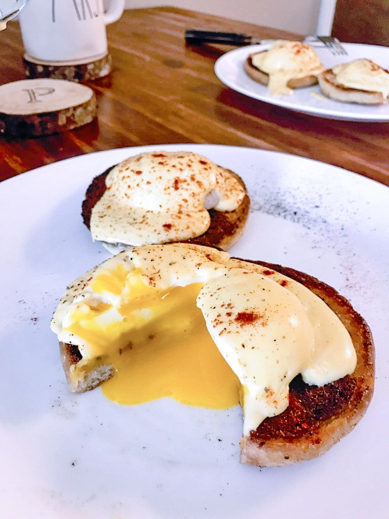 perfectly cooked time and temperature sous vide poached eggs benedict with oozing yolks