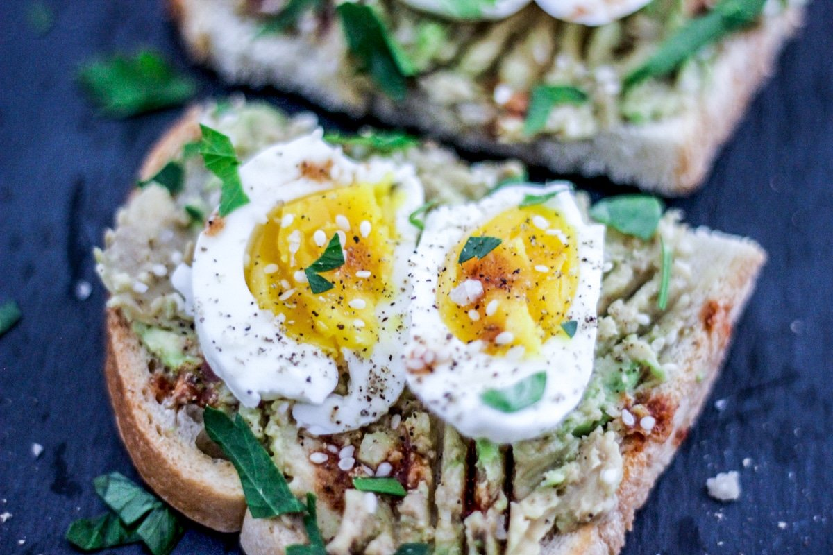 sous vide soft boiled egg avocado toast with fresh herbs