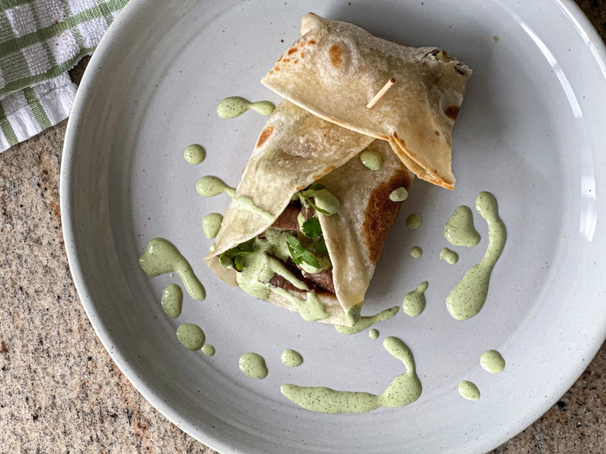 creamy jalapeno cilantro lime sauce with beef tacos