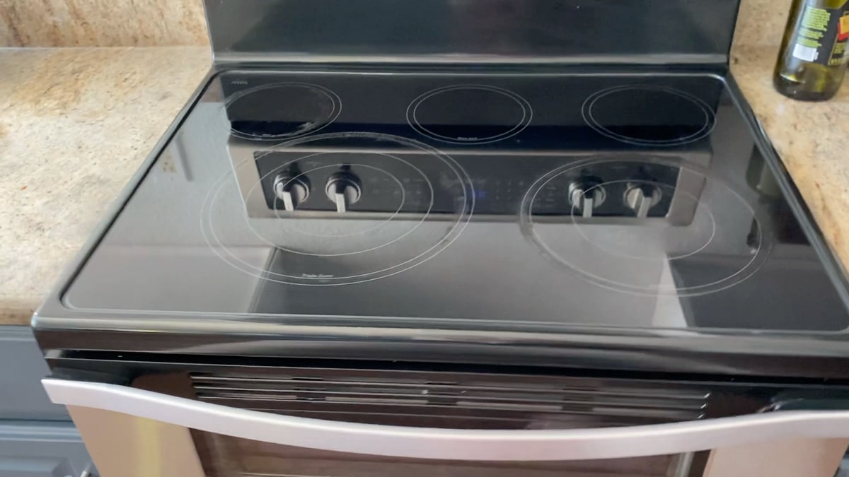 Clean flat black glass stove top after using product.