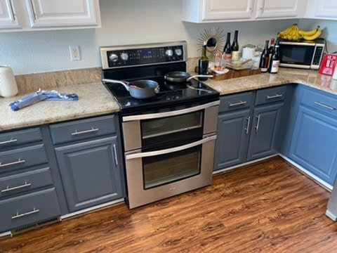 Cleaned kitchen with a clean oven stovetop.