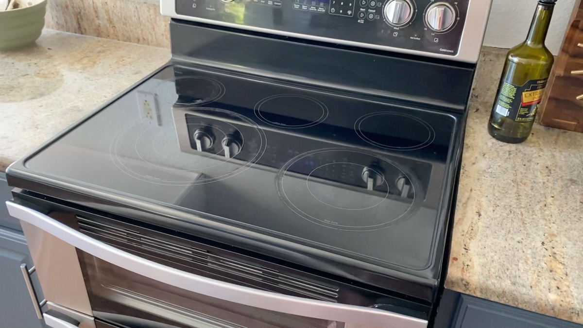 Clean flat black glass stove top.