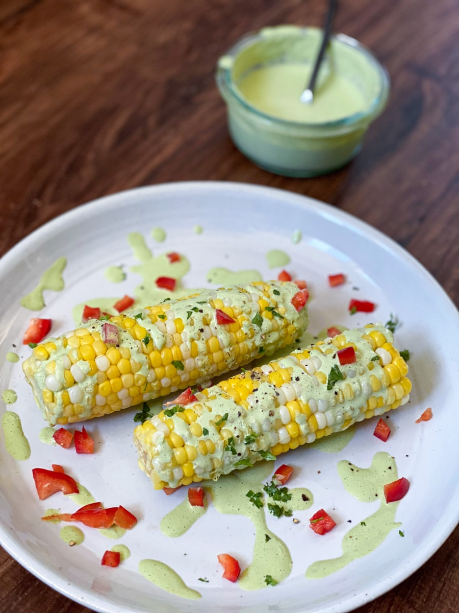 serving sous vide sweet corn with jalapeno sauce
