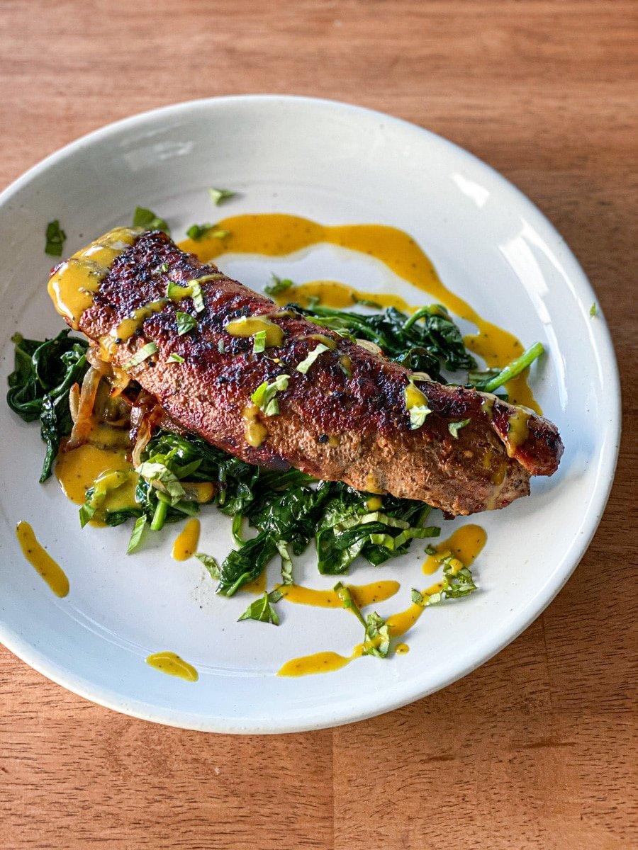 sous vide pork dish with mustard bbq sauce and spinach.jpg