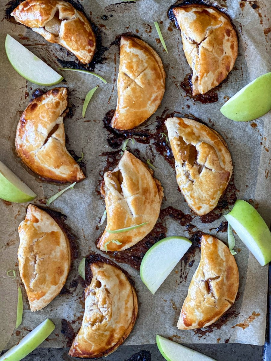 mini apple hand pies on a baking sheet with Granny Smith apples