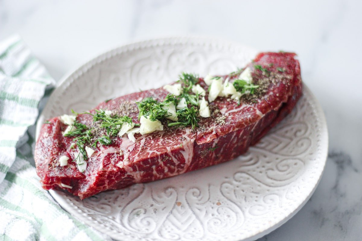 raw sous vide denver steak with dill and garlic