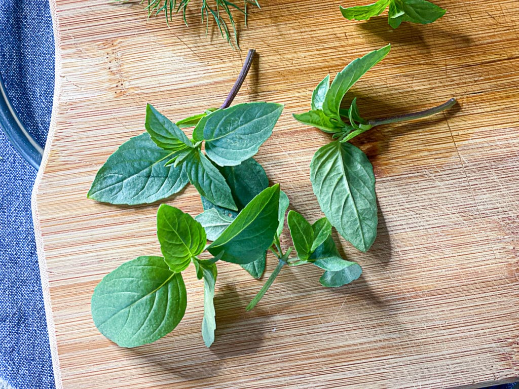 fresh cut aerogarden herbs on a cutting board