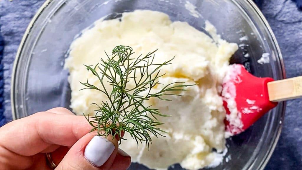adding fresh dill to mashed potatoes