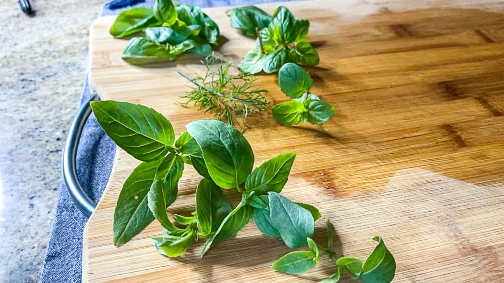 fresh herbs for cooking on cutting board