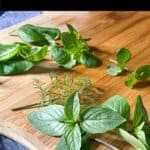 cook with fresh herbs graphic with basil on a cutting board