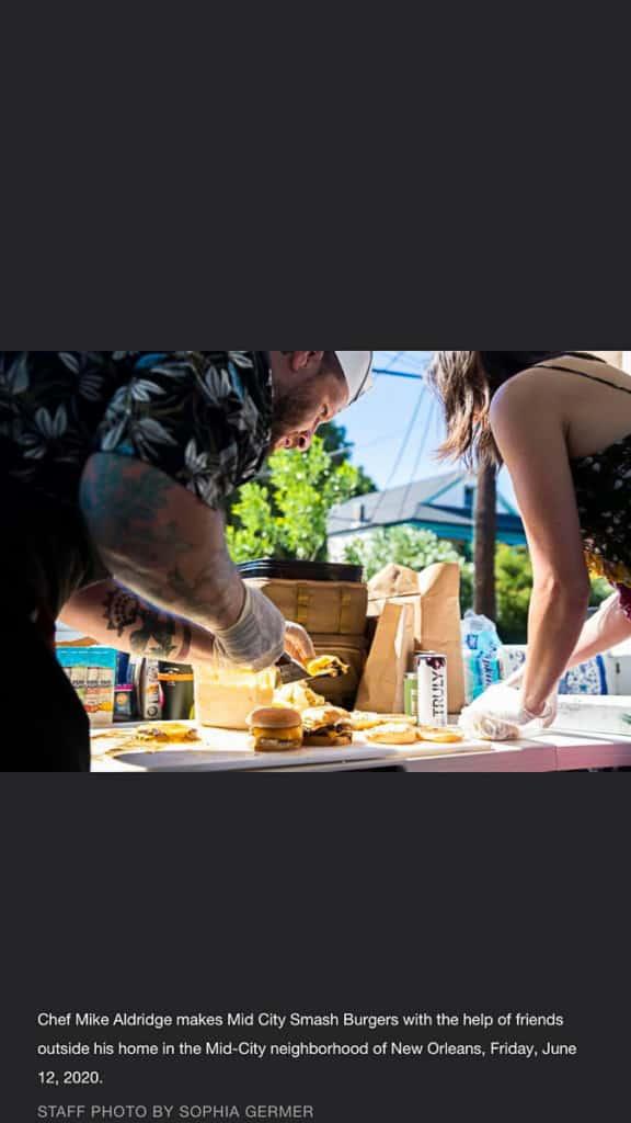 man and woman assembling burgers