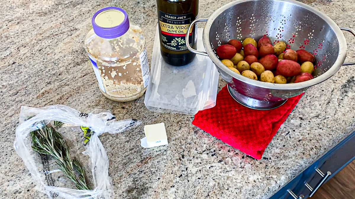Ingredients for sous vide little potatoes recipe laid out on countertop.
