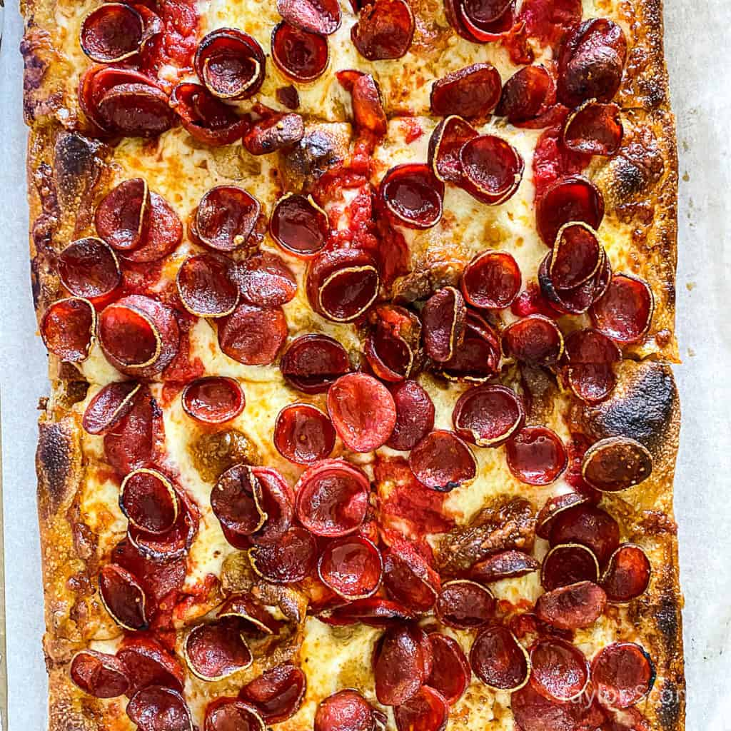 pepperoni pizza sliced into squares