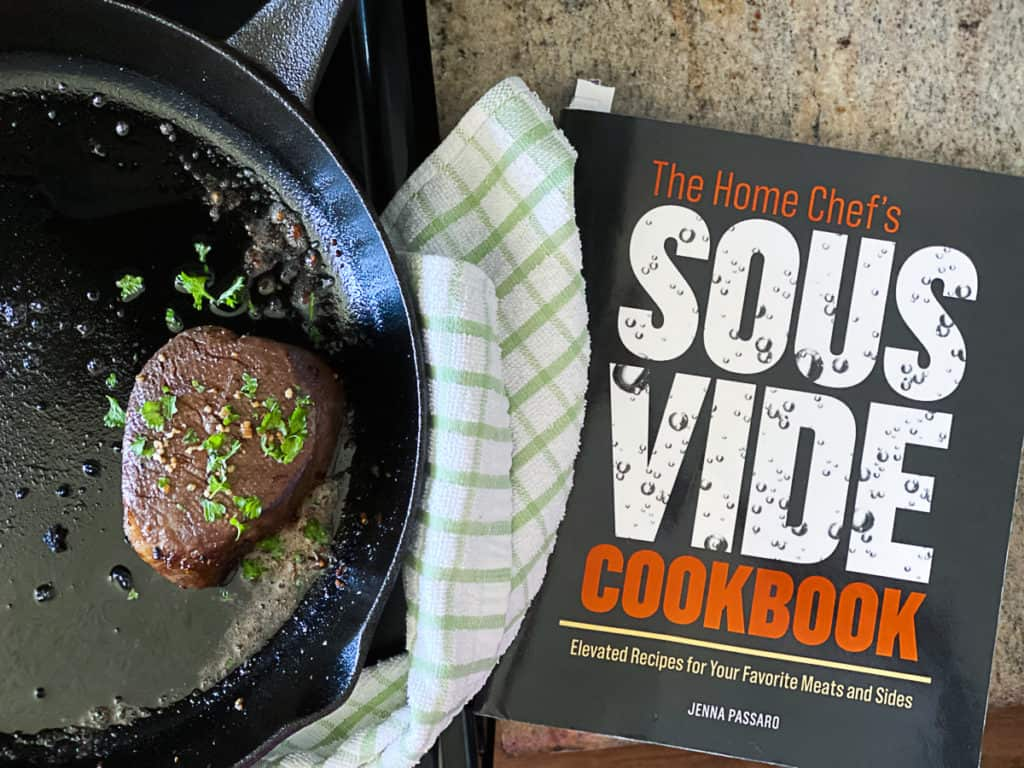 The Home Chef's Sous Vide cookbook next to a pan with fillet mignon steak.