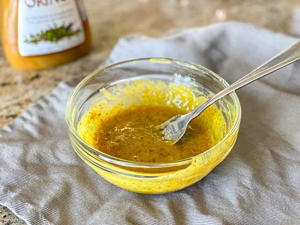 Closeup shot of homemade honey mustard sauce for sous vide pork dish.