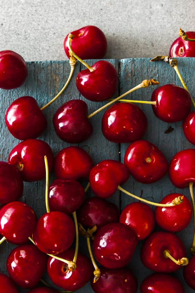 Top shot of spring cherries on a table.
