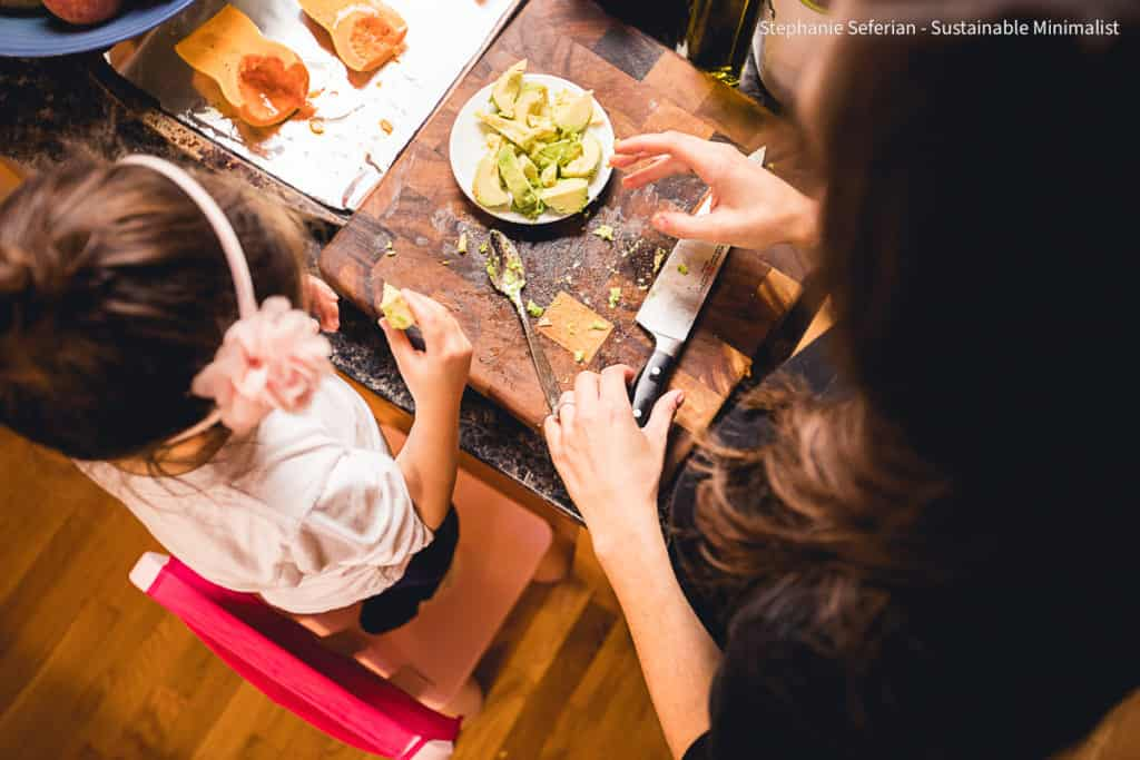 Top down shot of child and woman cooking together.