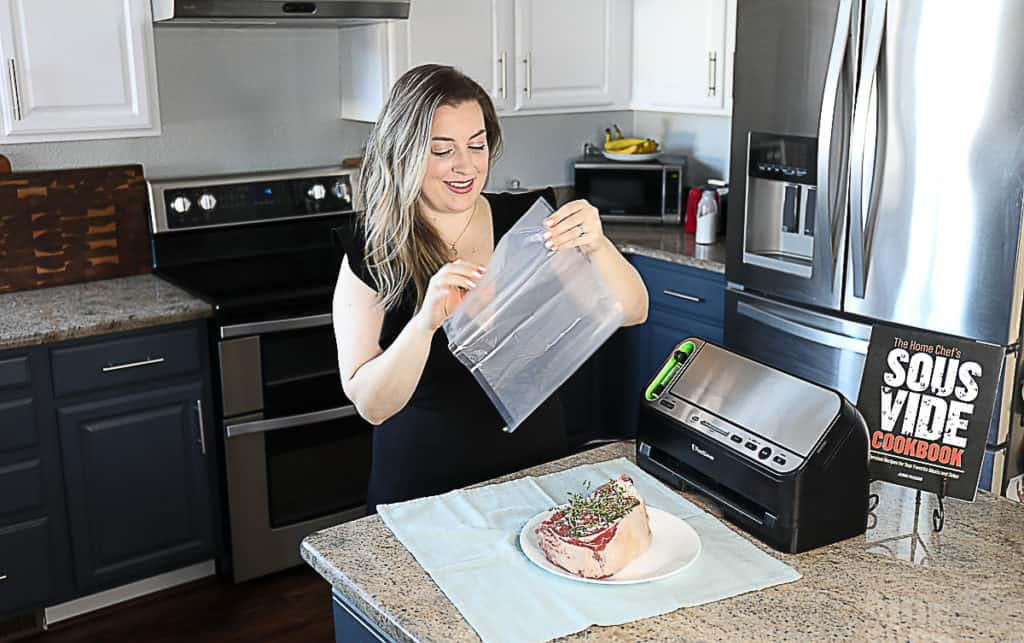 Jenna Passaro cooking sous vide food with the home chef's sous vide cookbook.