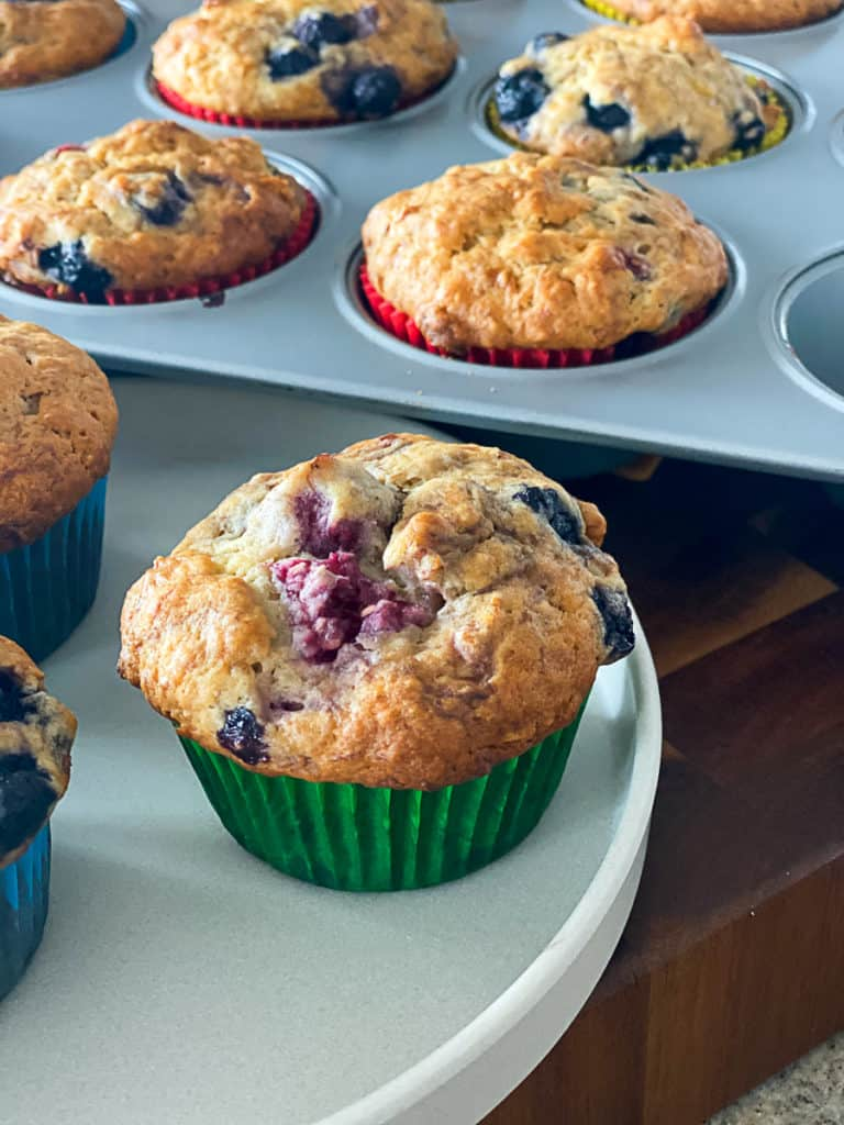 Side shot of raspberry and blueberry banana muffins.