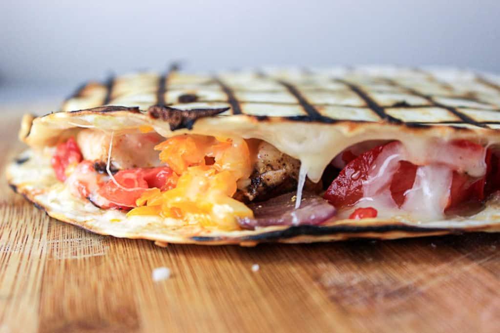 Side shot view of frozen tortilla quesadilla.