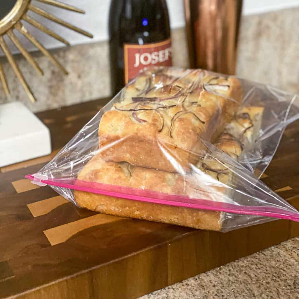 Side shot of ziplock bags of frozen bread.