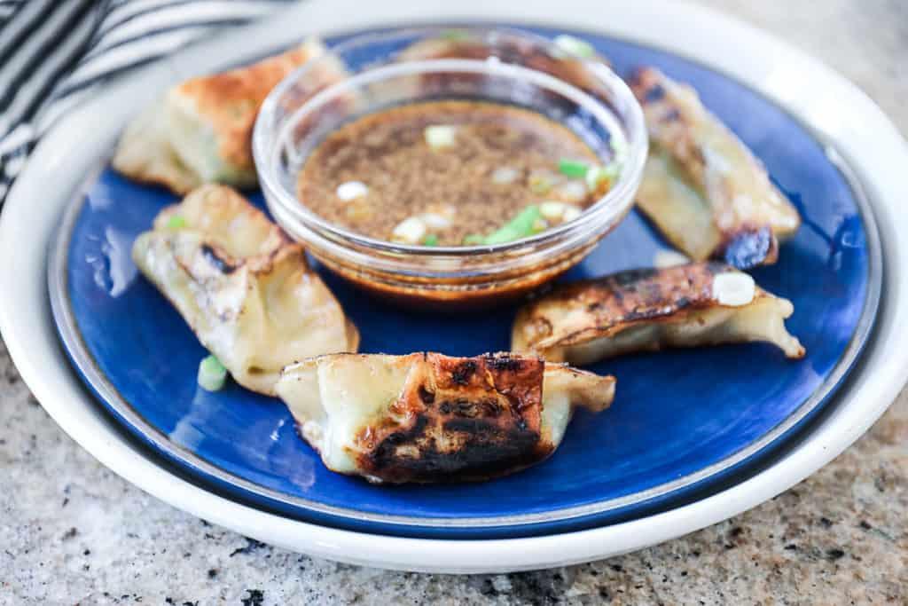 Side shot of browned Cooking Trader Joe's Thai Vegetable Gyoza.