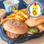 Logo of Dave's Hot Chicken restaurant with menu items including nashville style chicken sandwiches and sauce and sides.