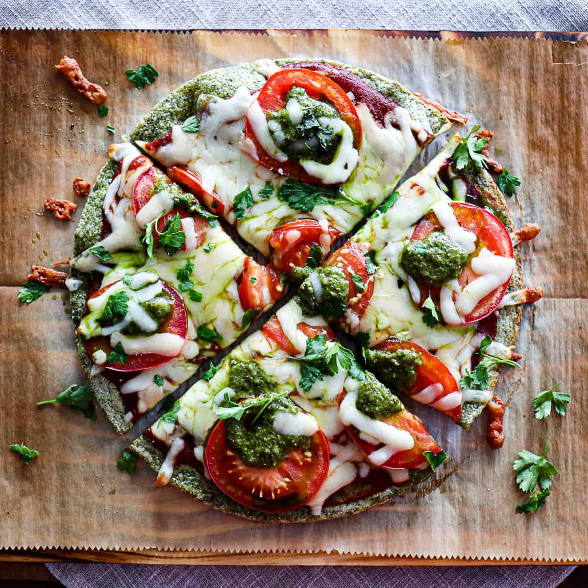 Top down shot of Gluten Free Pizza On Trader Joe's Broccoli Pizza Crust on a cutting board.