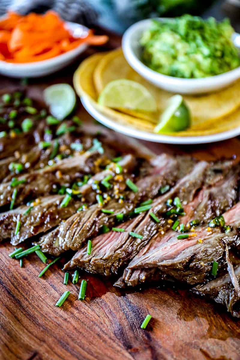 Image of marinated steak with taco ingredients.
