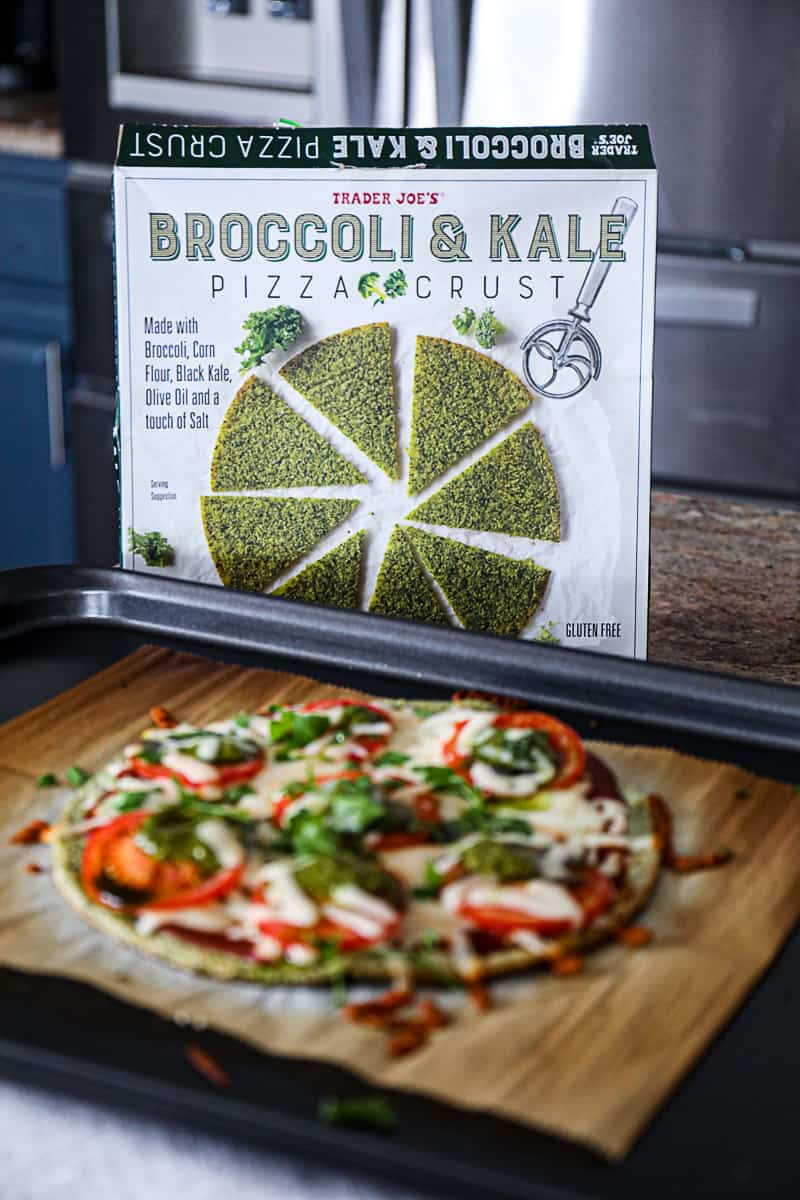 Side shot of Trader Joe's Broccoli And Kale Pizza Crust package with gluten free pizza.