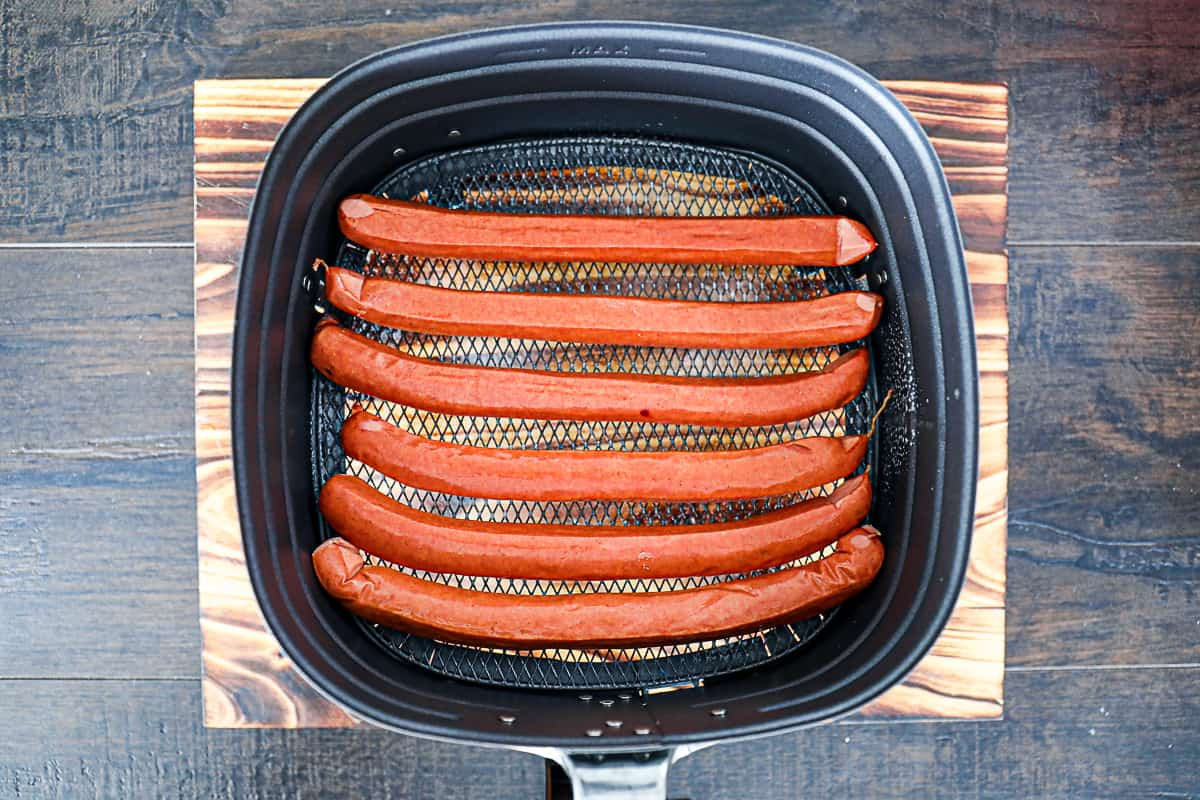 Air Fryer Baskets with Hot Dogs.