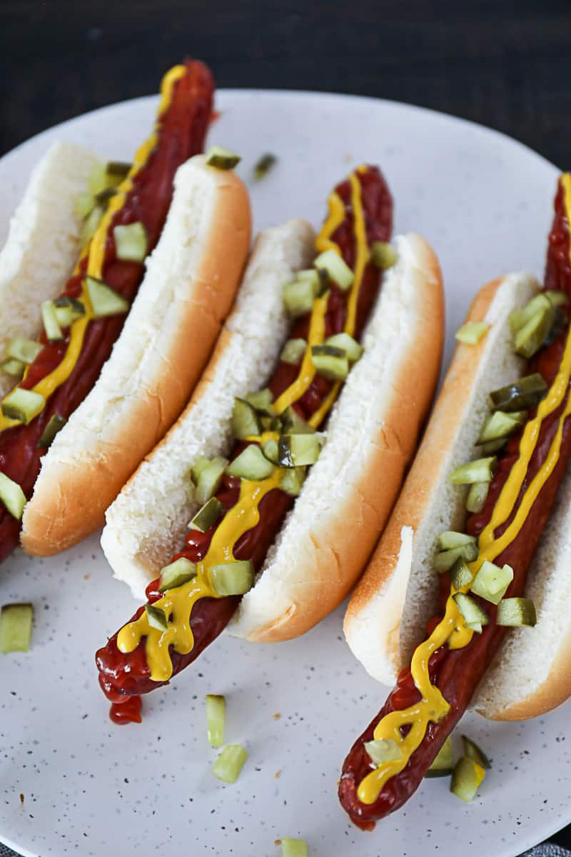Air Fryer Hot Dogs with condiments relish ketchup mustard.