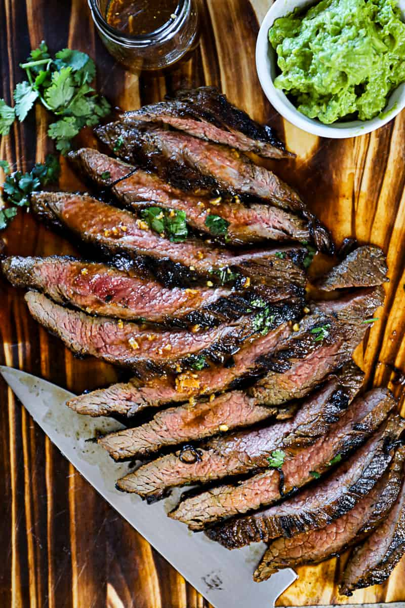 Top down shot of Flank Steak Marinated then seared in a cast iron skillet.