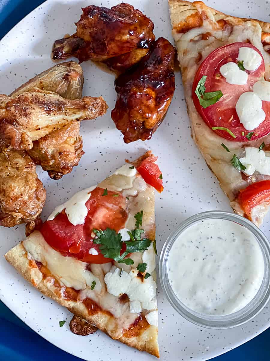 Top down shot example of convection oven pizza recipes vs air fryer wings recipes.