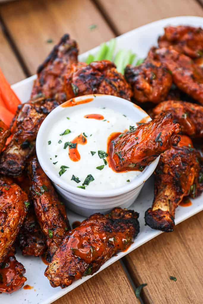 Grilled chicken wings with blue cheese dressing.