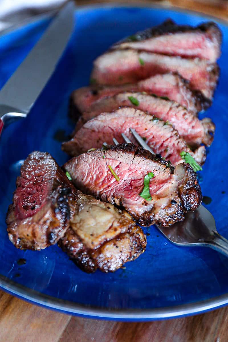 Closeup of cooked picanha steak medium rare.