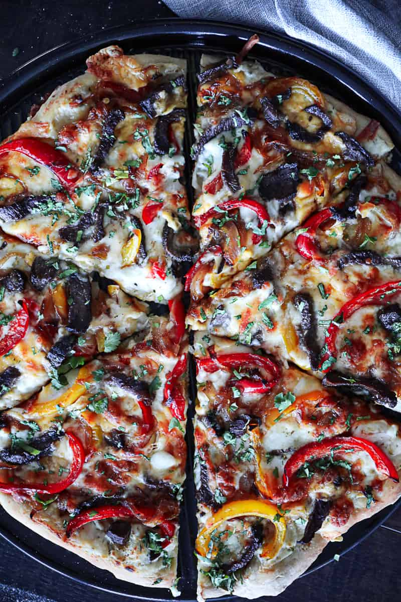 Pizza with toppings on par baked pizza dough