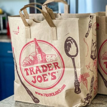 Side shot of brown Trader Joe's shopping bags on a counter.