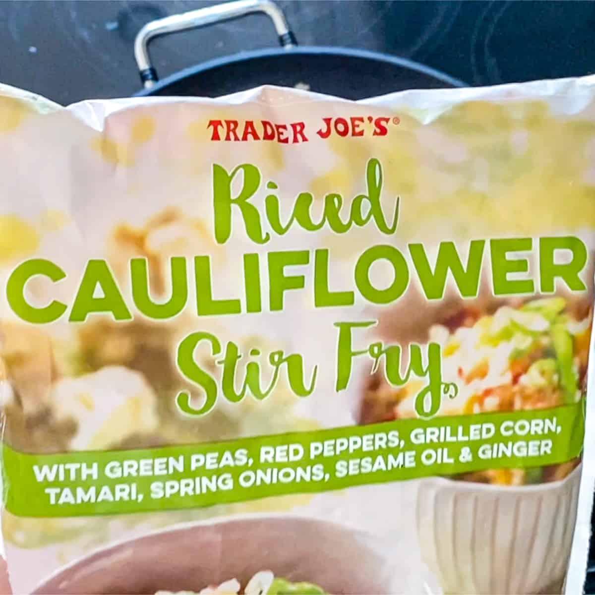 Closeup of bag of Trader Joe's riced cauliflower stir fry frozen bag.