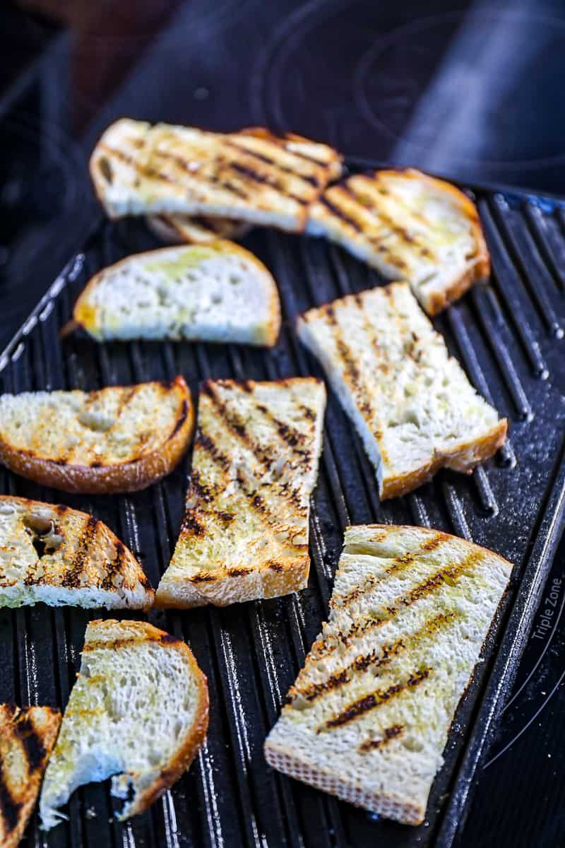 Demonstrating how to toast bread in a pan with grill marks Sip Bite Go