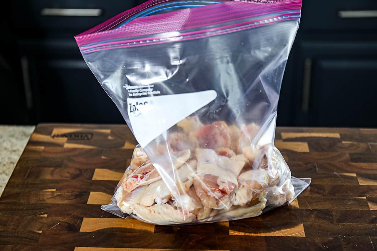 Dry rub seasoned chicken wings in a bag