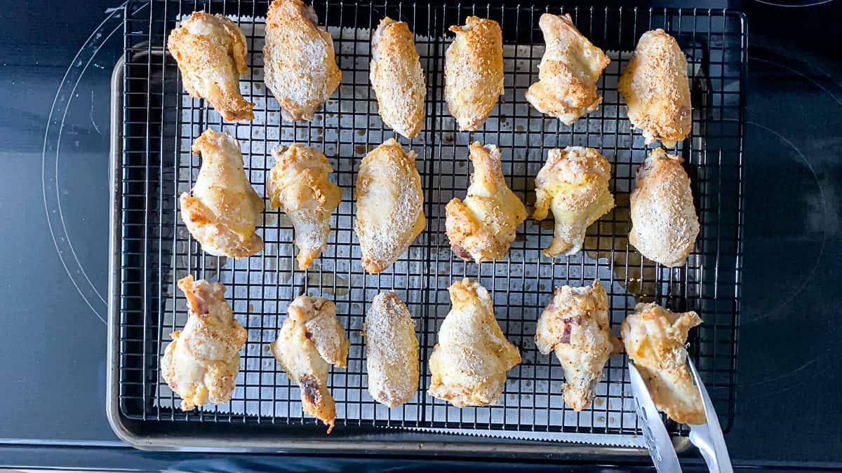 Oven Baked Lemon Pepper Chicken Wings on a baking rack.