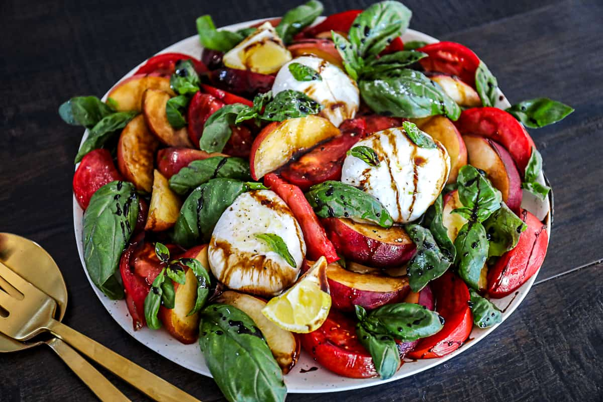 Serving Fresh Peach Salad side dish with silverware.