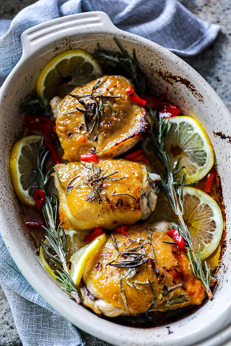 Baked Chicken Thighs in baking dish.